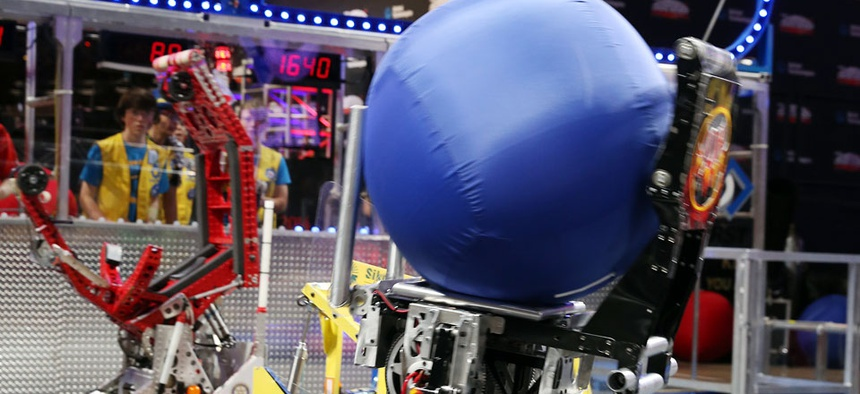 Robots compete at the FIRST robotics competition.