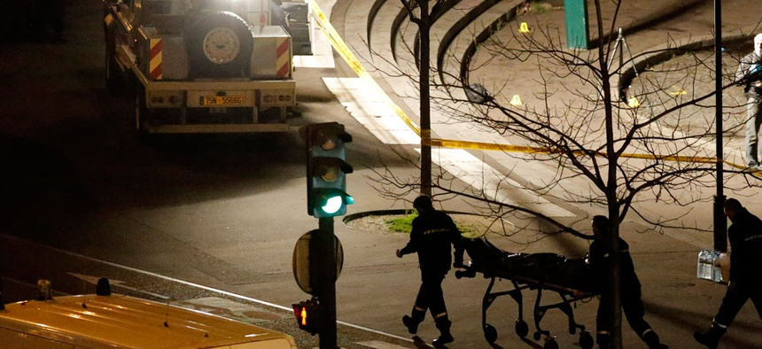 A body is wheeled away from a kosher grocery store which was the scene of a hostage taking in Paris, Friday, Jan. 9, 2015.