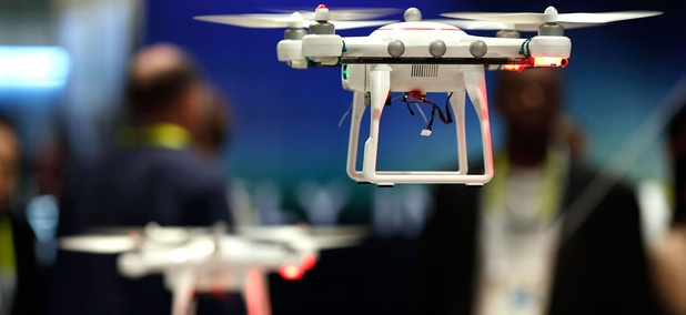 Drones fly at the Autel booth during the International CES Wednesday, Jan. 7, 2015.