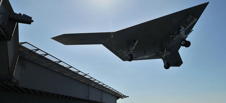 A naval Unmanned Carrier Launched Surveillance and Strike aircraft (UCLASS) takes off.