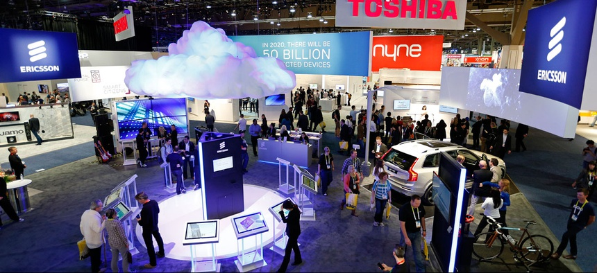 People walk through the Ericsson booth during the International CES Friday, Jan. 9, 2015, in Las Vegas.