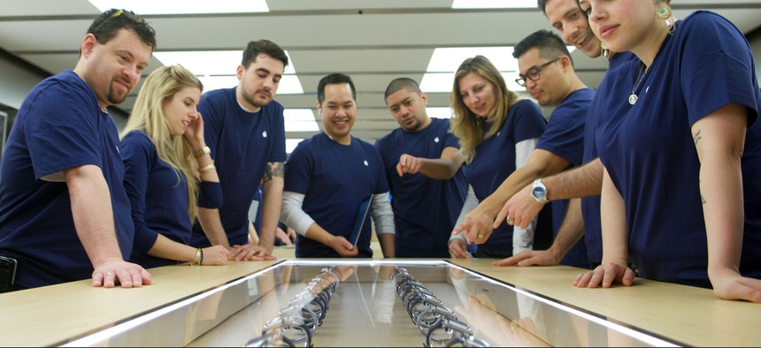 Apple Team Members prepare for the release of the Apple Watch at the Eaton Centre Apple Store on Friday, April 10, 2015 in Toronto.