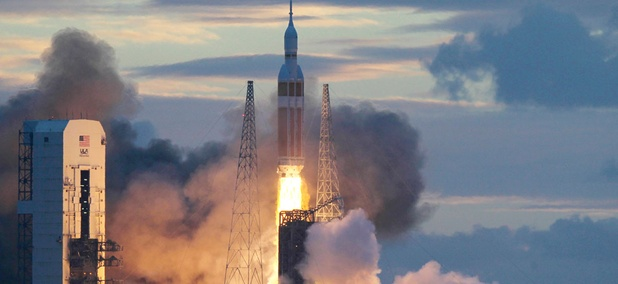 A NASA Orion capsule on top of a Delta IV rocket lifts off on its first unmanned orbital test flight from Complex 37 B at the Cape Canaveral Air Force Station, Friday, Dec. 5, 2014