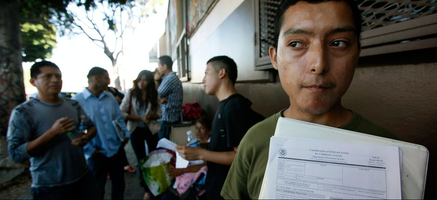 Illegal immigrant Layios Roberto waits outside the offices of Coalition for Humane Immigrant Rights in Los Angeles Wednesday, Aug. 15, 2012.