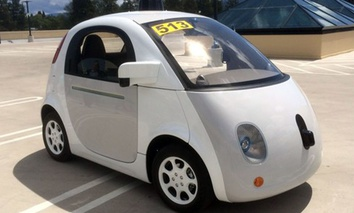 Google's latest prototype waits to give rides on the roof of the Google-X building.