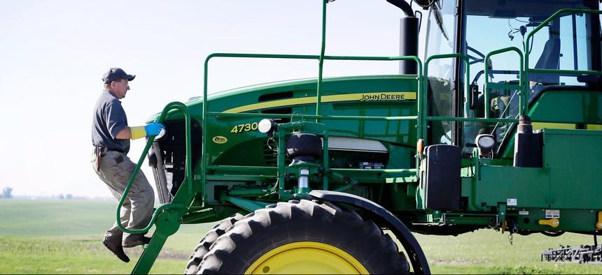 Ray Gaesser climbs onto a sprayer on his farm, Wednesday, June 11, 2014, near Corning, Iowa.