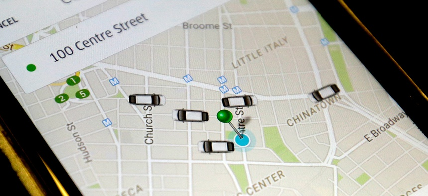 The Uber app displays cars available to make a pickup in downtown Manhattan on a smart phone, in New York.