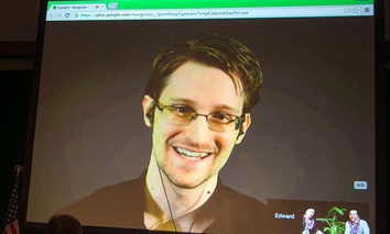 National Security Agency leaker Edward Snowden appears on a live video feed broadcast from Moscow at an event sponsored by the ACLU Hawaii in Honolulu.