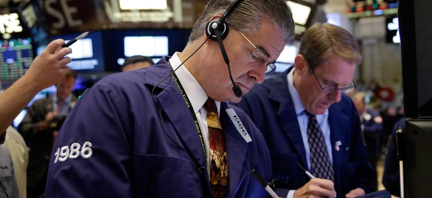 Trader Daniel Kryger works on the floor of the New York Stock Exchange, Thursday, July 9, 2015 in New York.