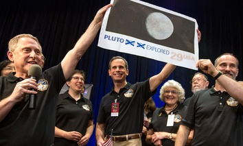 New Horizons crew members celebrate at the Johns Hopkins University Applied Physics Laboratory (APL) in Laurel, Md.