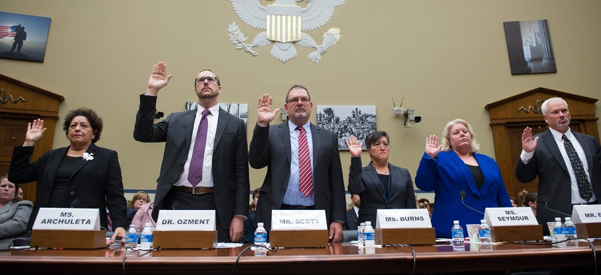 Third from left, Sylvia Burns, Interior CIO, testifies before the House Oversight and Government Reform committee's hearing on the Office of Personnel Management data breach.