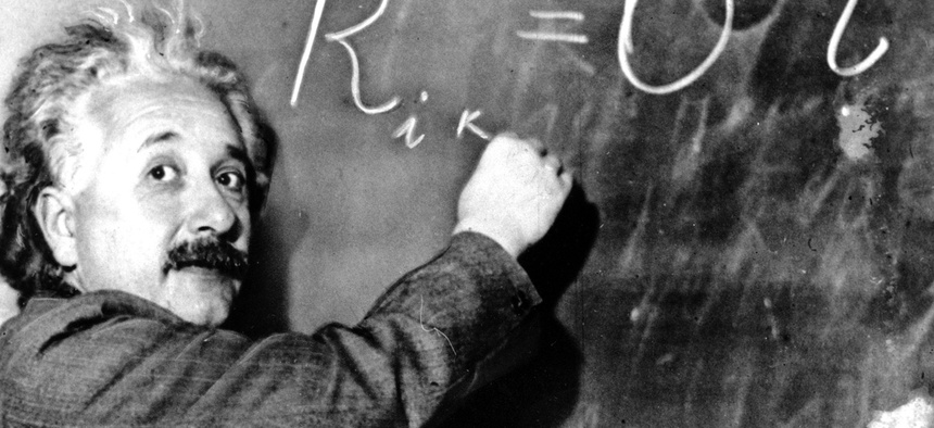 Dr. Albert Einstein writes out an equation for the density of the Milky Way on the blackboard at the Carnegie Institute, Mt. Wilson Observatory headquarters in Pasadena, Calif.