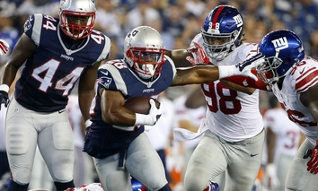 New England Patriots James White (28) runs the ball in the first half of an NFL football game against the New York Giants Thursday, Sept. 3, 2015.