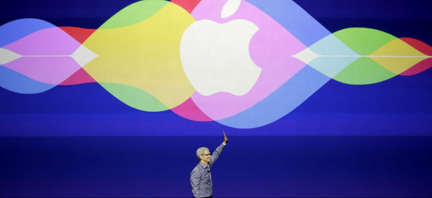 Apple CEO Tim Cook waves during the Apple event in San Francisco, Wednesday, Sept. 9, 2015.