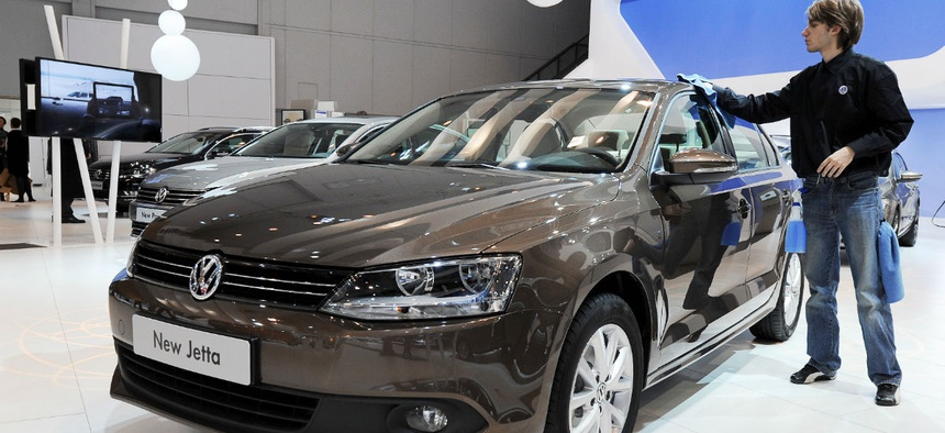 A VW worker dusts the new VW Jetta during the 89th European Motorshow at Brussels' Expo, Belgium, Friday Jan. 14, 2011.