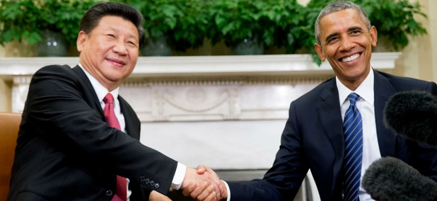 President Barack Obama shakes hands with Chinese President Xi Jinping during their meeting in the Oval Office of the White House.