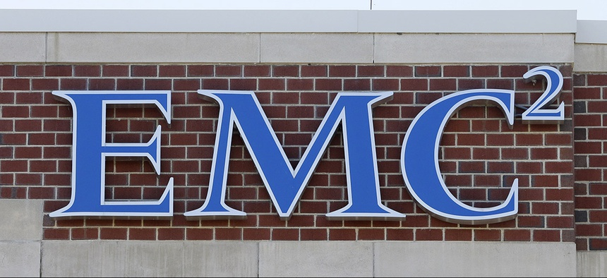 An EMC logo is attached to a building on the company's corporate campus, Monday, Oct. 12, 2015, in Hopkinton, Mass. Dell is buying data storage company EMC in a deal valued at approximately $67 billion.