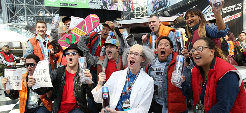 Fans celebrates the 30th anniversary of Back to the Future with a replica Café 80's space at New York Comic Con.