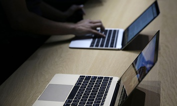 The new two-pound MacBook is on display in a demo room following an Apple event Monday, March 9, 2015.