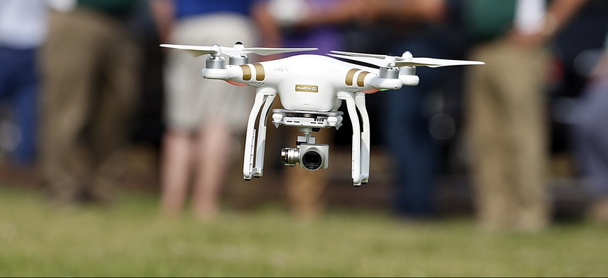 A DJI Phantom 3 drone is flown during a drone demonstration at a farm.