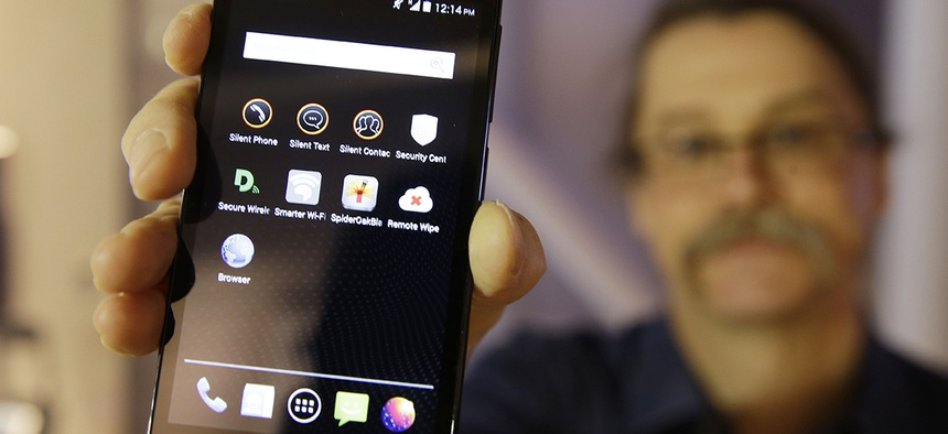 Silicon Valley pioneer and Silent Circle co-founder Jon Callas holds up Blackphone with encryption apps displayed on it,