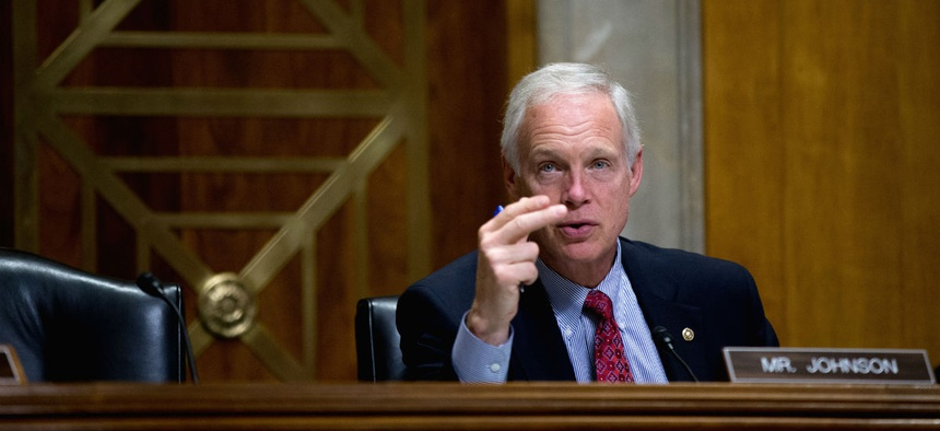 "Senate Foreign Relations Committee member Sen. Ron Johnson, R-Wis., questions Deputy Assistant Secretary of State Benjamin Ziff, on Capitol Hill in Washington, Tuesday, Nov. 3, 2015, during the committee's hearing entitled: ""Putin's Invasion of Ukraine an"