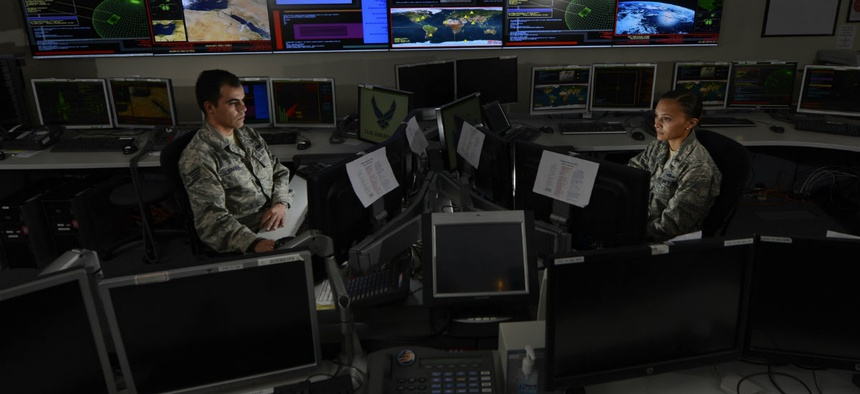 Staff Sgt. Alex Garviria, 721st Communication Squadron senior systems controller, and 2nd Lt. Rachel James, 721st CS crew commander, work in the Global Strategic Warning and Space Surveillance System Center at Cheyenne Mountain Air Force Station, Colo., S