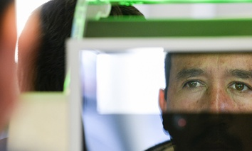 A pedestrian crossing from Mexico into the United States at the Otay Mesa Port of Entry has his facial features and eyes scanned at a biometric kiosk, Dec. 10, 2015, in San Diego.