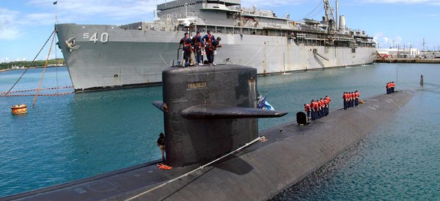 The fast attack submarine USS Salt Lake City prepares to go alongside USS Frank Cable in Apra Harbor, Guam.