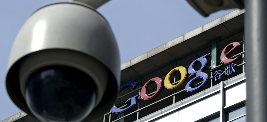 In this March 23, 2010 file photo, a surveillance camera is seen in front of the Google China headquarters in Beijing, China.
