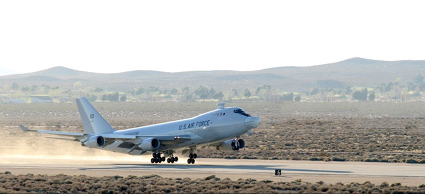 The YAL-1A Airborne Laser, a modified Boeing 747-400F, takes off from Edwards Air Force Base, California, on March 15 for a five-hour test mission.