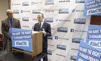 State Rep. Andy Josephson, left, listens as Joshua Decker, executive director of the American Civil Liberties Union of Alaska, speaks about two bills on data privacy at a news conference in in Juneau, Alaska, on Wednesday.