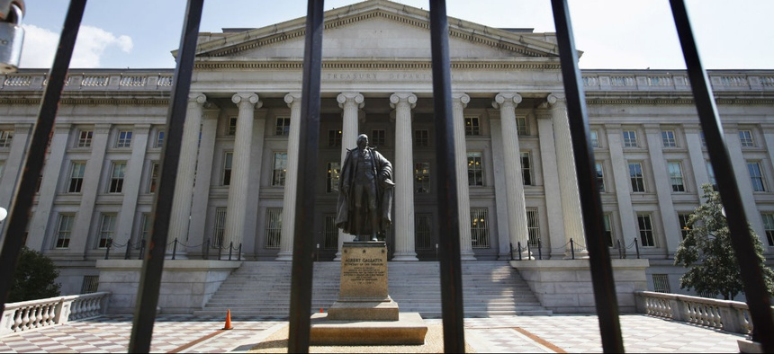 This Monday, Aug. 8, 2011, file photo, shows the Treasury Building in Washington.
