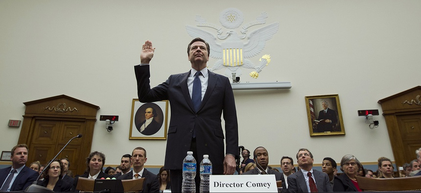 FBI Director James Comey testifies on Capitol Hill in Washington.