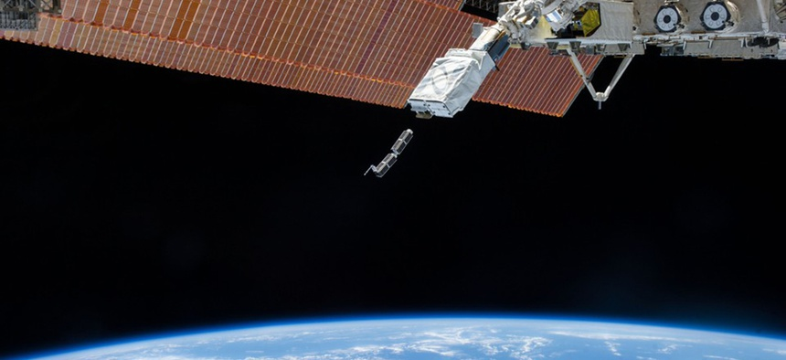 The International Space Station releases early Planet Labs satellites in February 2014.
