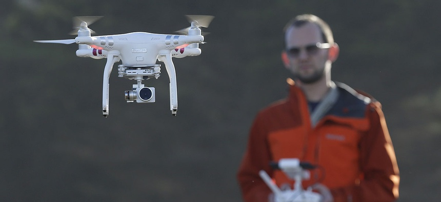 Trent Lukaczyk, an unmanned aerial vehicle engineer who builds and flies drones to monitor changes in the ocean environment, controls a DJI Phantom 3 Advanced drone to take photos and videos over the coastline in Pacifica, Calif.