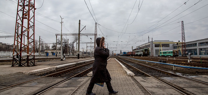 A local woman walks along a rail-road crossing in Debaltseve, eastern Ukraine.