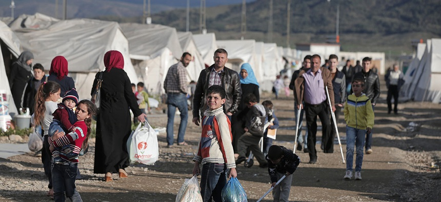 Syrian refugees go about their lives at a refugee camp for Syrian refugees in Islahiye, Gaziantep province, southeastern Turkey, Wednesday, March 16, 2016.