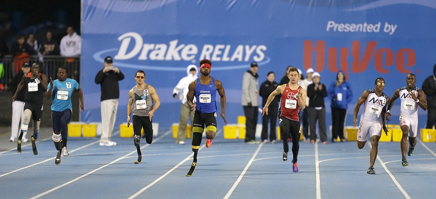 Richard Browne, center, leads the field to the finish line in the men's paralympic 200-meter dash at the Drake Relays athletics meet, Friday, April 24, 2015.