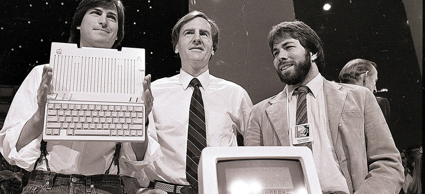 Steve Jobs, left, chairman of Apple Computers, John Sculley, center, president and CEO, and Steve Wozniak, co-founder of Apple, unveil the new Apple IIc computer in San Francisco in 1984.