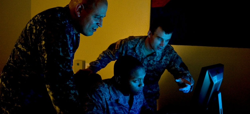 U.S. Navy Petty Officer 1st Class Joel Melendez, Naval Network Warfare Command information systems analysis, U.S. Air Force Staff Sgt. Rogerick Montgomery, U.S. Cyber Command network analysis, and U.S. Army Staff Sgt. Jacob Harding, 780th Military Intelli