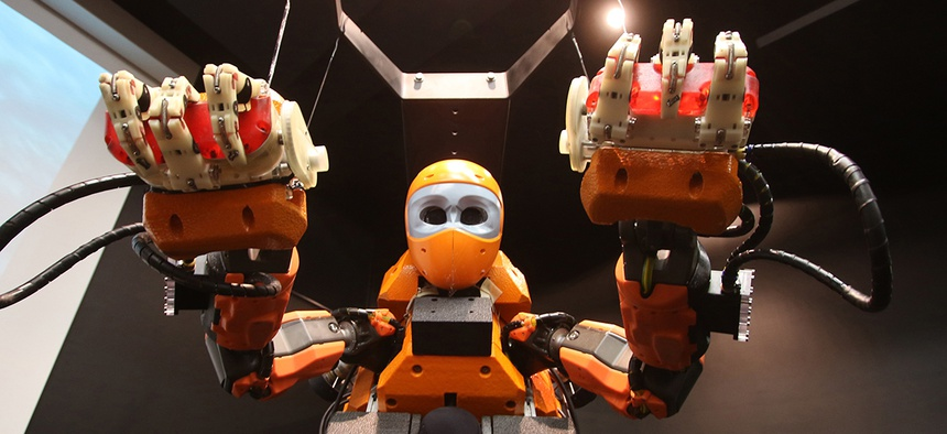 "French officials show off ""Ocean One"" an underwater diving robot at the history museum in Marseille, southern France, Thursday, April 28, 2016."