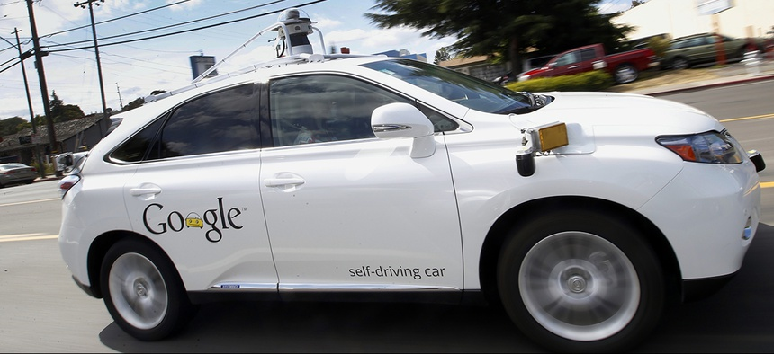 Google's self-driving Lexus drives along a street during a demonstration at Google campus in Mountain View, Calif.