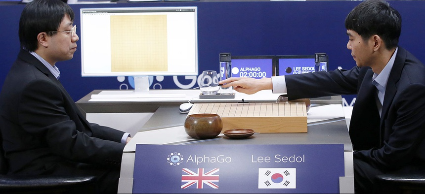South Korean professional Go player Lee Sedol, right, puts the first stone against Google's artificial intelligence program, AlphaGo, during the final match of the Google DeepMind Challenge Match in Seoul, South Korea.