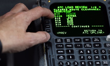 United Parcel Service Capt. Gregg Kastman demonstrates to media the use of electronic messaging from the air traffic control tower to his plane at Newark Liberty International Airport, Thursday, May 21, 2015, in Newark, N.J.