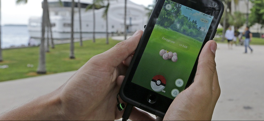 A Pokemon, is found by a Pokemon Go player, Tuesday, July 12, 2016, at Bayfront Park in downtown Miami.