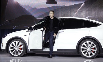 Elon Musk, CEO of Tesla Motors Inc., introduces the Model X car at the company's headquarters in Fremont, Calif.