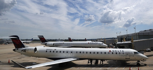 Delta Air Lines planes are seen on the tarmac at Washington's Ronald Reagan Washington National Airport, Monday, Aug. 8, 2016.