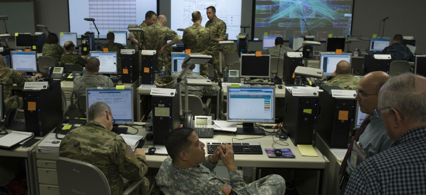 Participants at Cyber Guard 2016 works through a training scenario during the nine-day exercise Suffolk, Va., June 16, 2016.