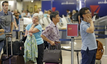 Delta passengers stand in line as the carrier slogged through day two of its recovery from a global computer outage, Tuesday, Aug. 9, 2016, in Salt Lake City.